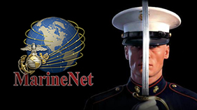 Marine in full dress with sword in front of his face standing next to Marine that logo