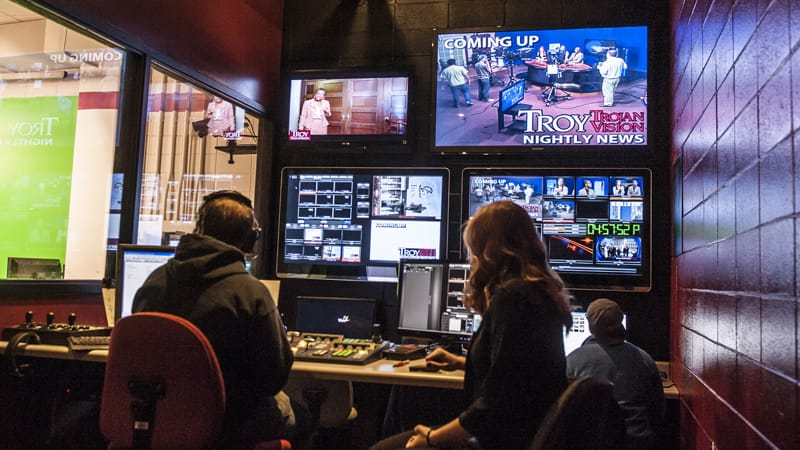 Students work in the TrojanVision control room to produce a 30 minute newscast