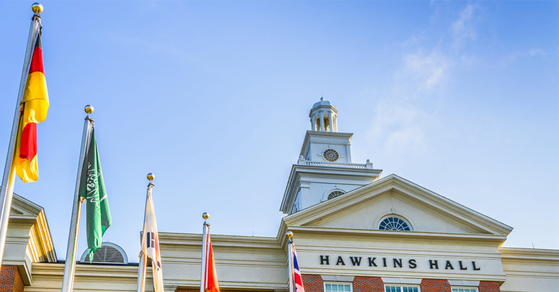 Flags in front of Hawkins Hall building