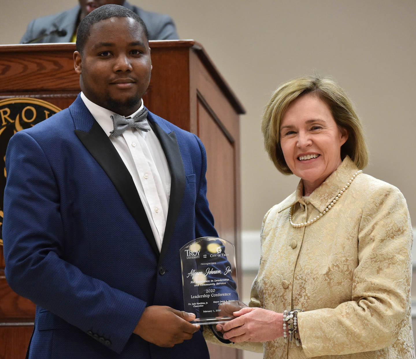 Herman Johnson, Jr. receiving student award from Barbara Patterson