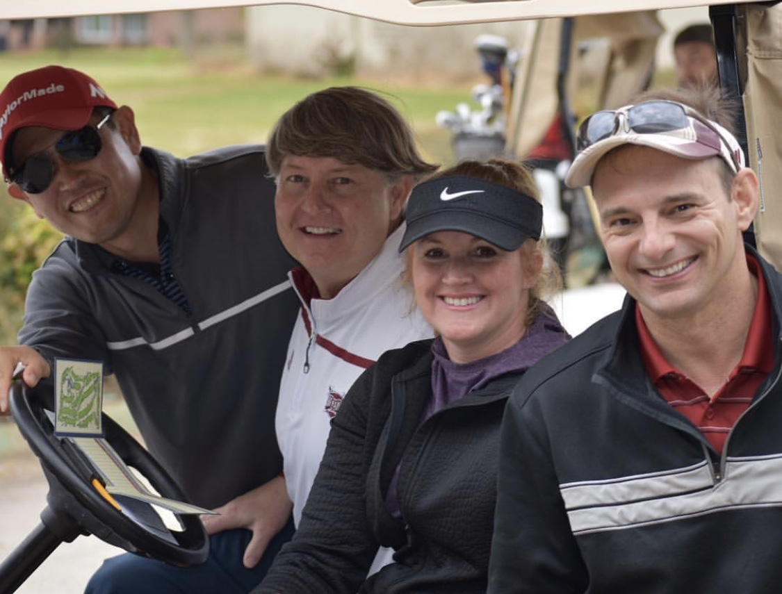 HSTM faculty overseeing the golf tournament