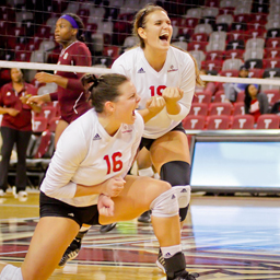 Troy University volleyball players celebrate