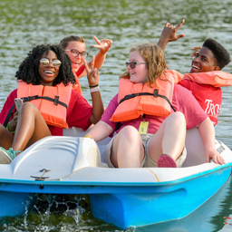 Participants in the Youth Leadership Form enjoy a ride on a pedal boat