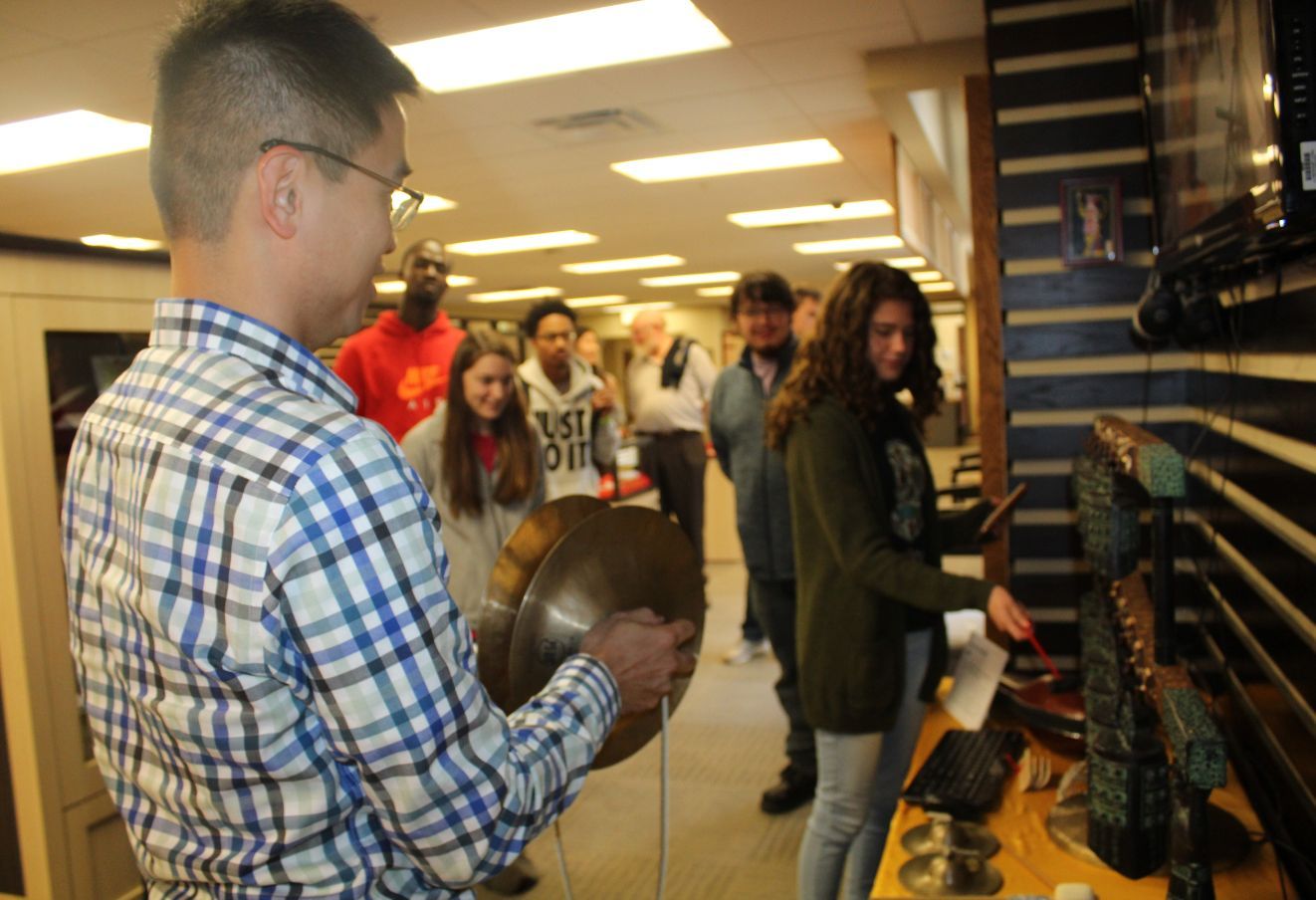 Students play with traditional Chinese instruments.
