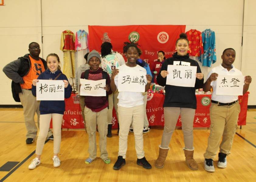 Kids showing off their hanzi