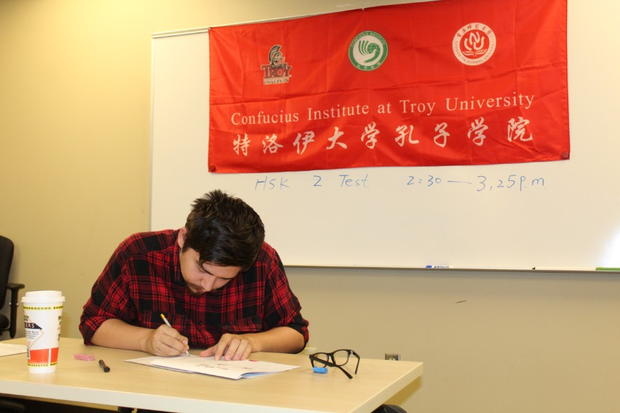 some guy with facial hair taking the hsk test