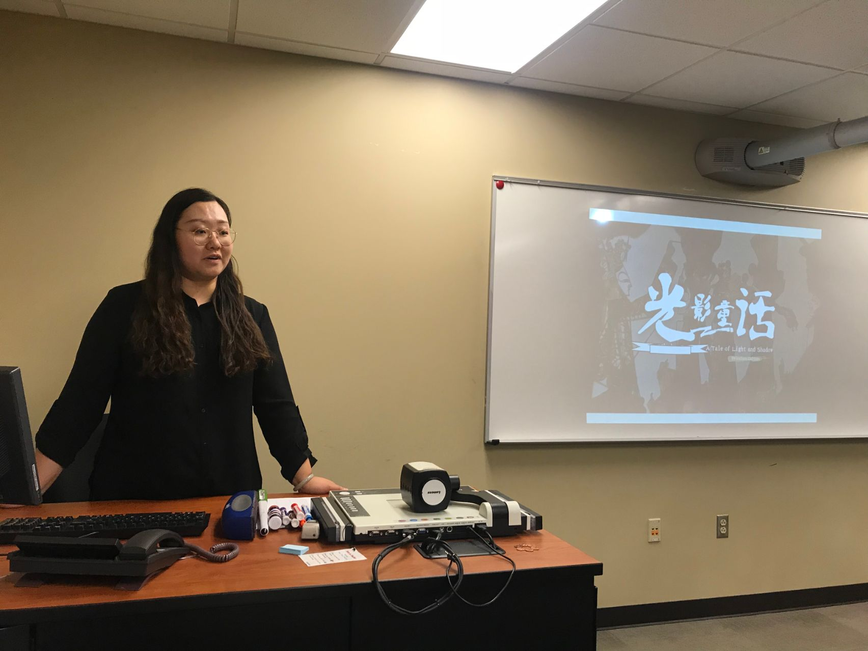 Visiting Scholar, Yunchu Zhang gives the students a history of Chinese puppetry and plays them a video.
