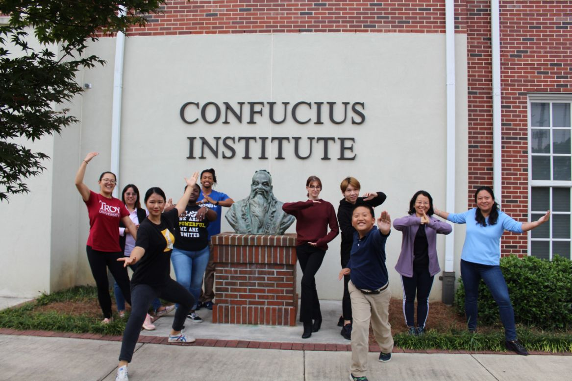 The students and Visiting Scholars posed with the Confucius statue outside of CIT after the Tai Chi practice in a group picture.