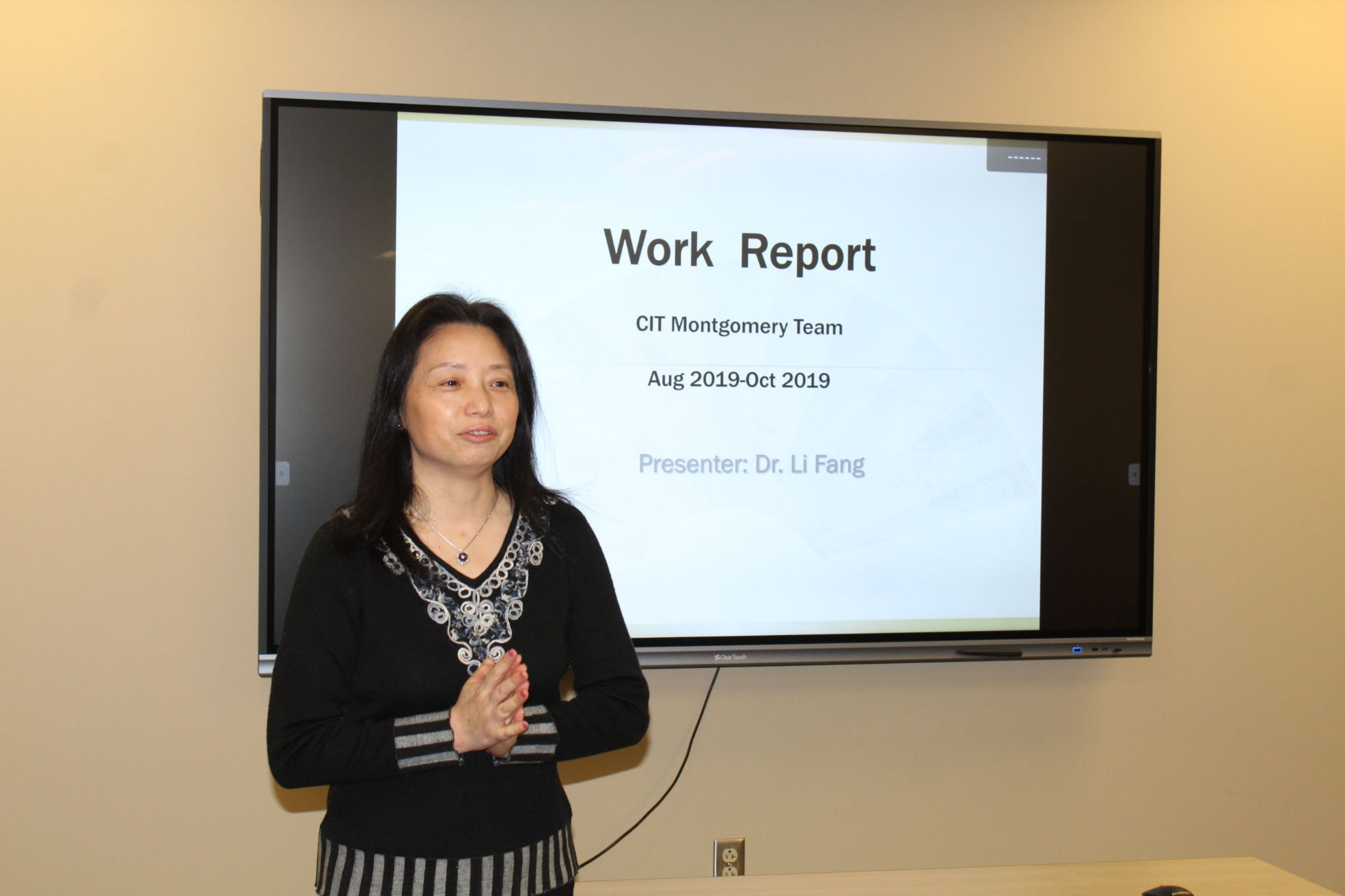 Dr. Fang from Montgomery gives a report at the seminar.