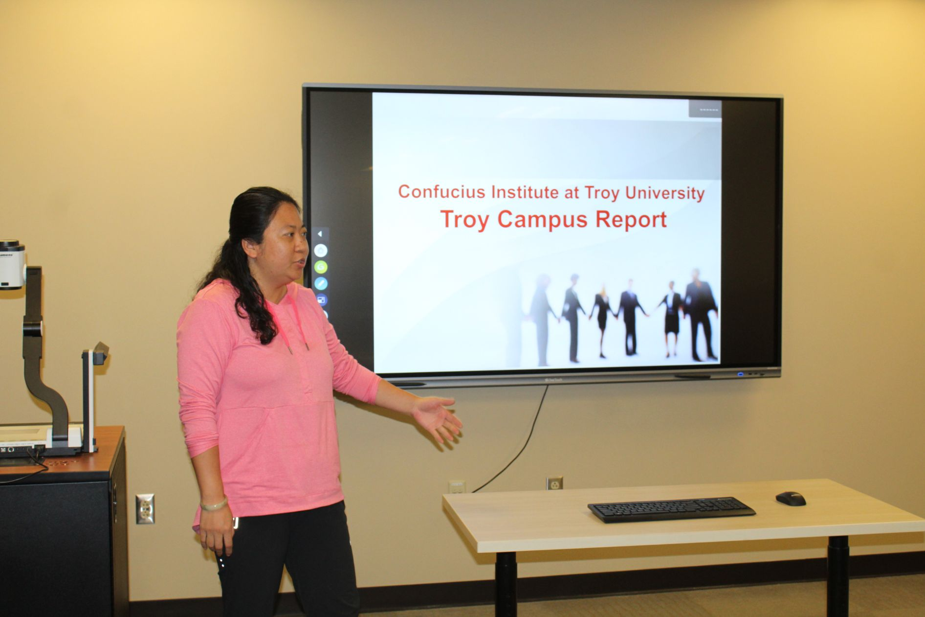Dr. Zhang gives a presentation about the work of the Troy University campus.