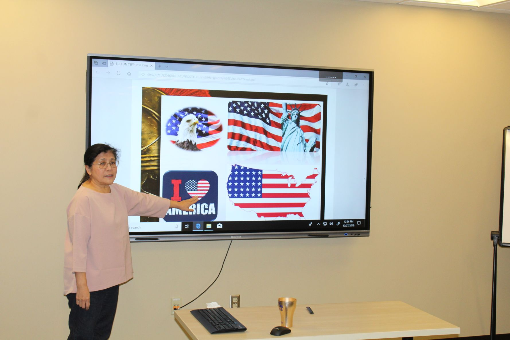 Dr. Xu presents an exposition on the culture shock facing immigrants to the US.