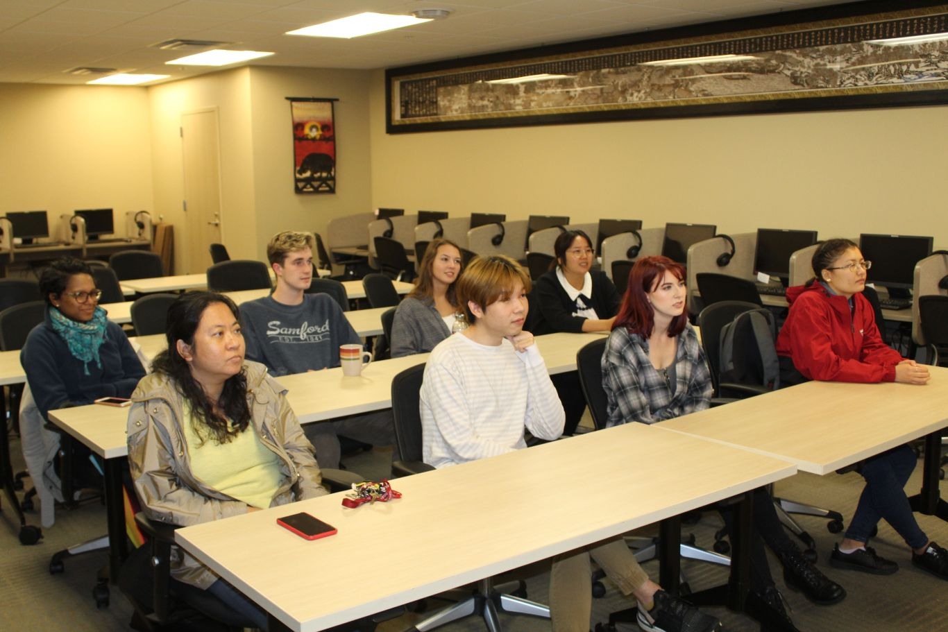 The students listen intently to the lecture on the history of the traditional Chinese games.