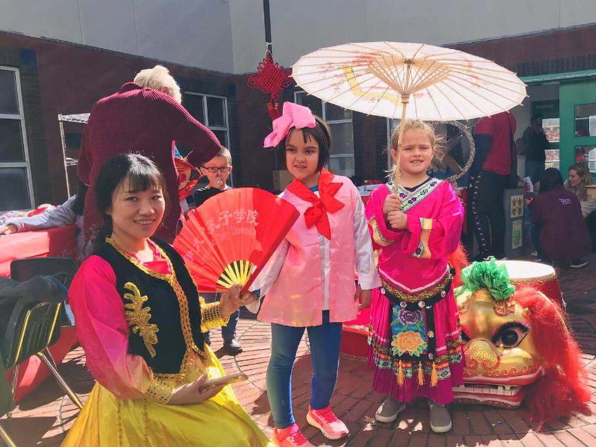 Young girls show off traditional Chinese female clothing.