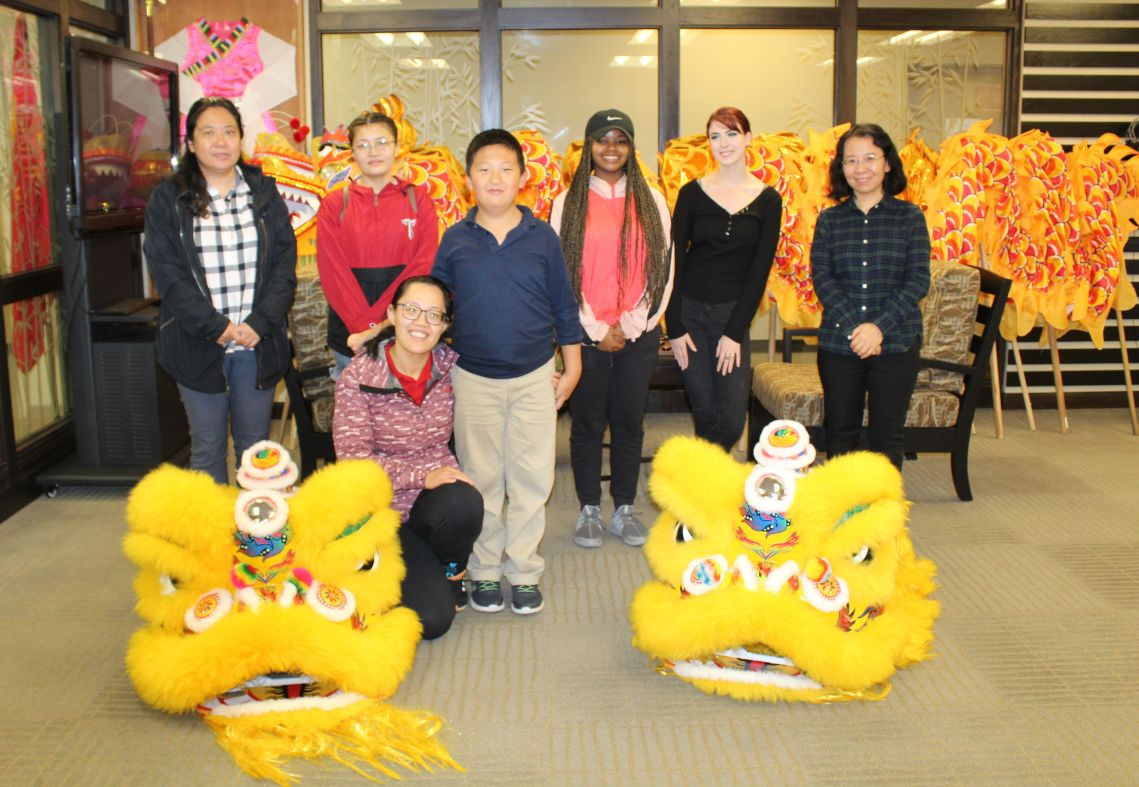 The students and Visiting Scholars pose in a group picture in the CIT Exhibition Center with the lion heads.