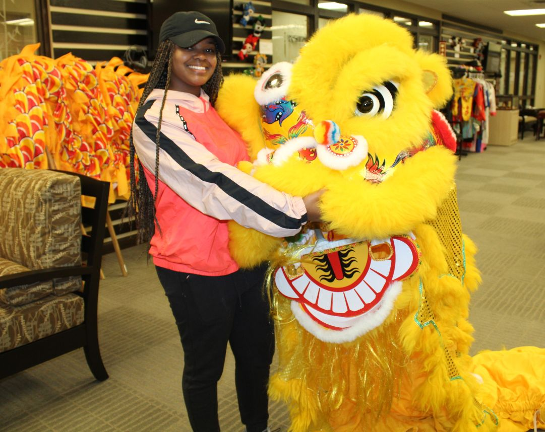One student poses with the lion head she danced with.