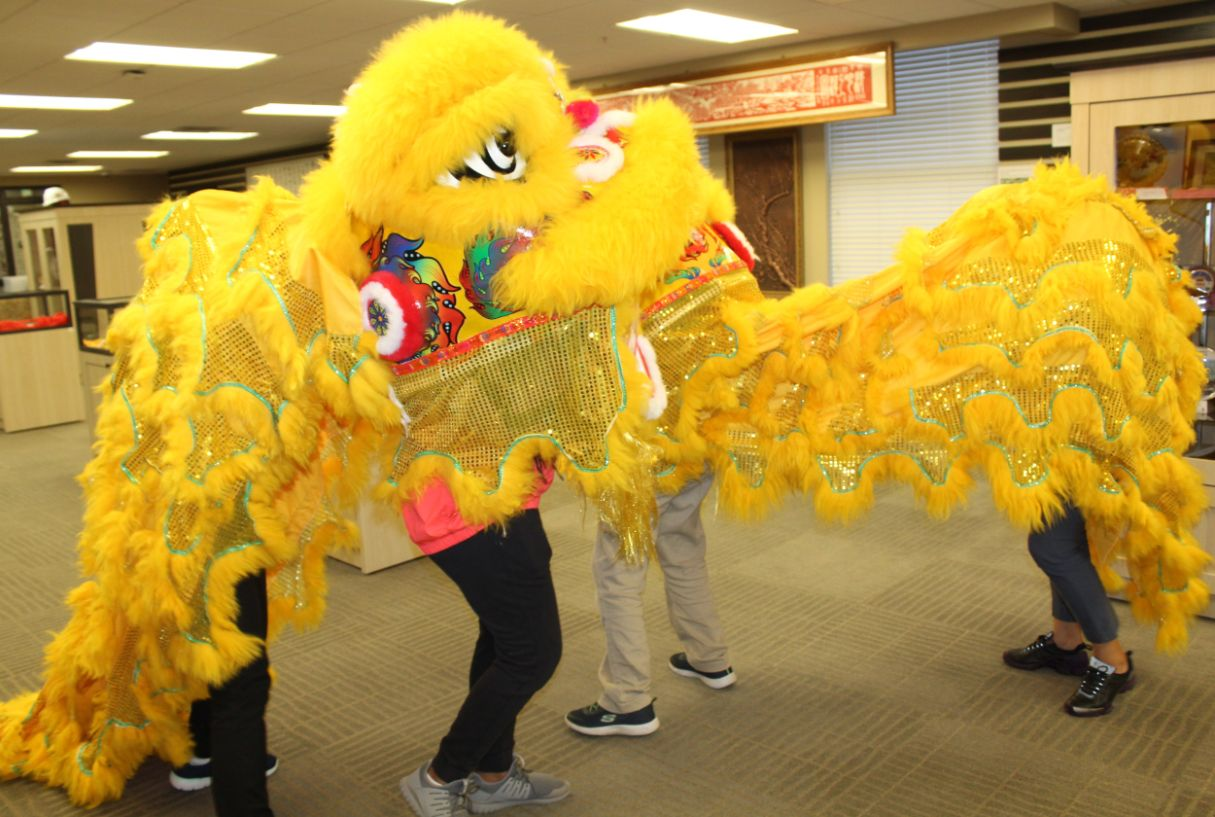 Students and Scholars perform the twin lion dance.