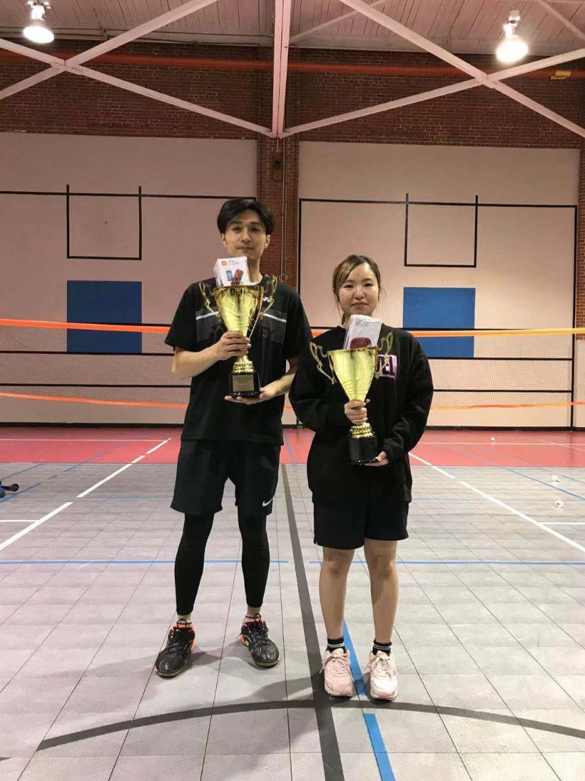 The first-place winners for the male and female divisions pose together.