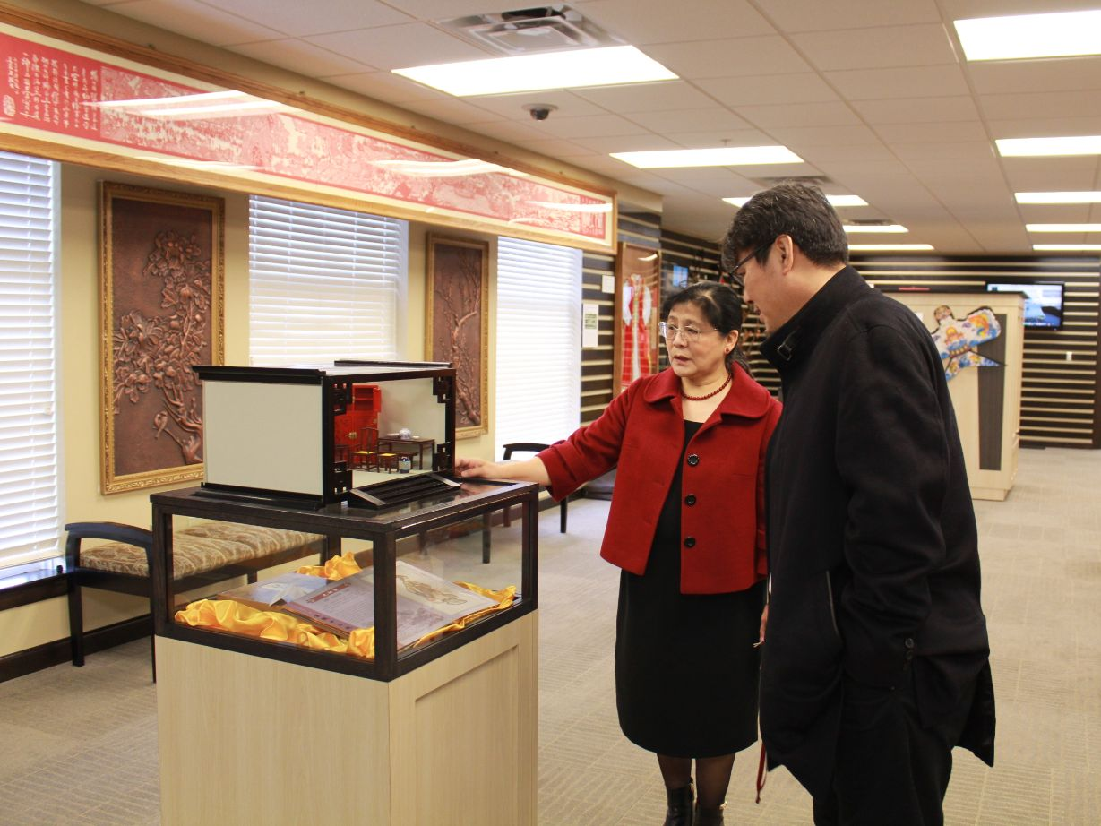 Dr. Xu gives Tao a tour of the CIT Exhibition Center.