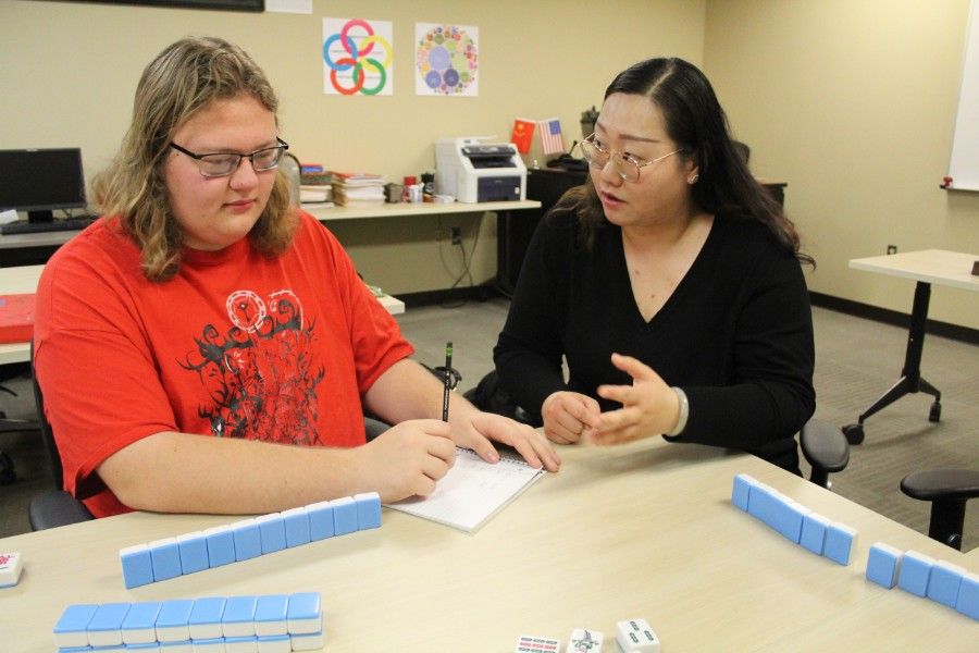 Yunchu Chang showed the students how to play chinese mahjong