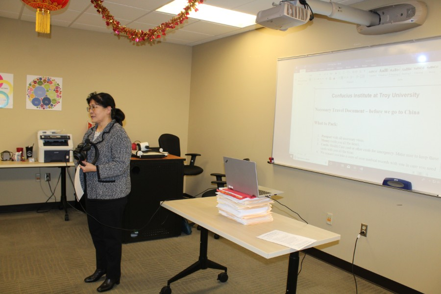 Dr. Hong Xu was presenting necessary information to students going on china trip
