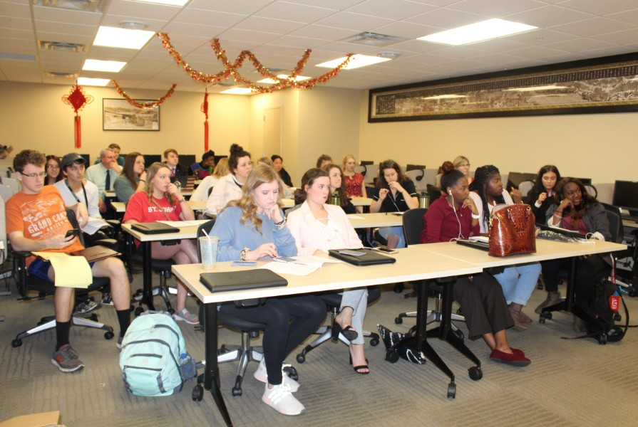 troy students were attentive to Dr. Xu orientation