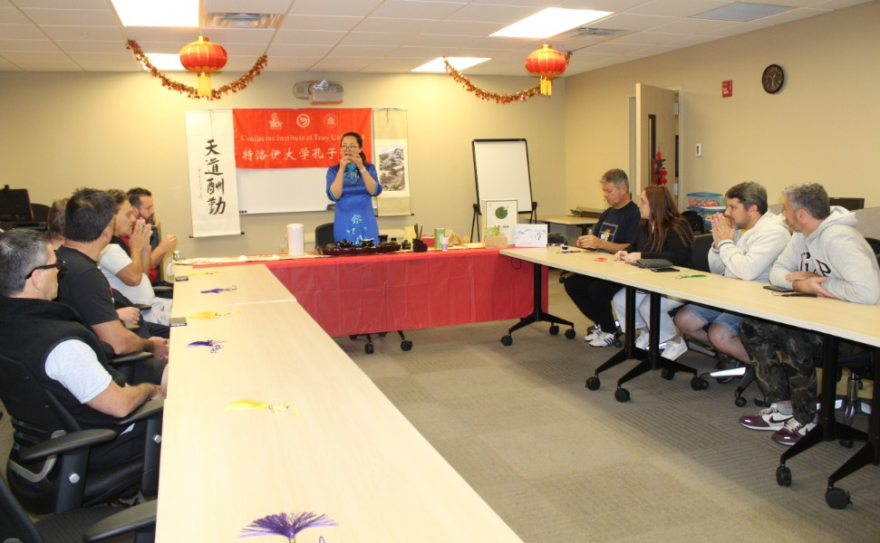 visiting scholar gave the presentation about chinese tea ceremony