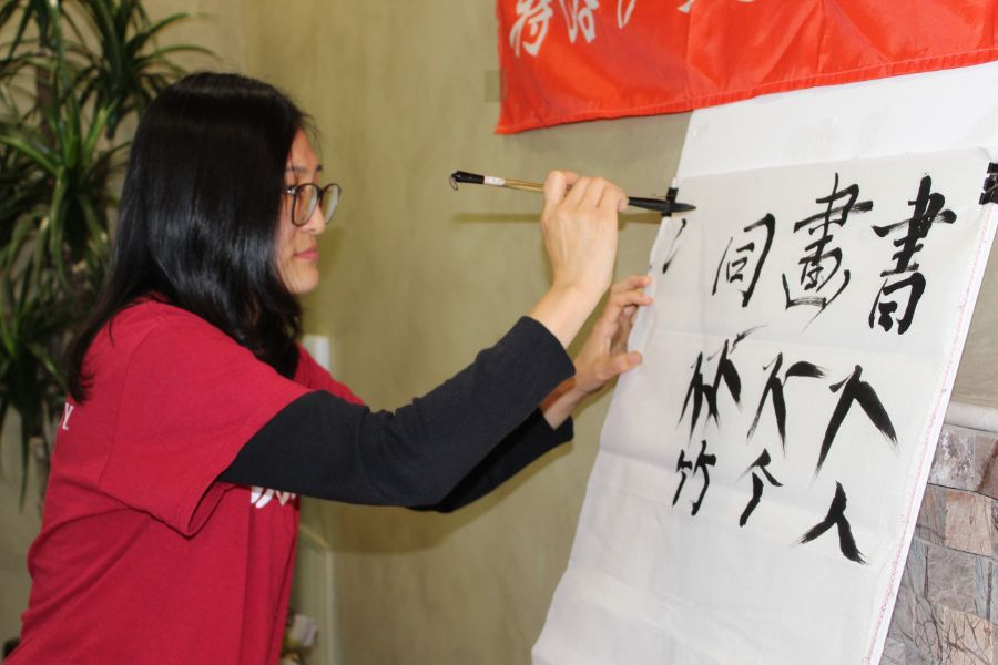 visiting scholar instructed Troy students on how to draw Chinese caligraphy