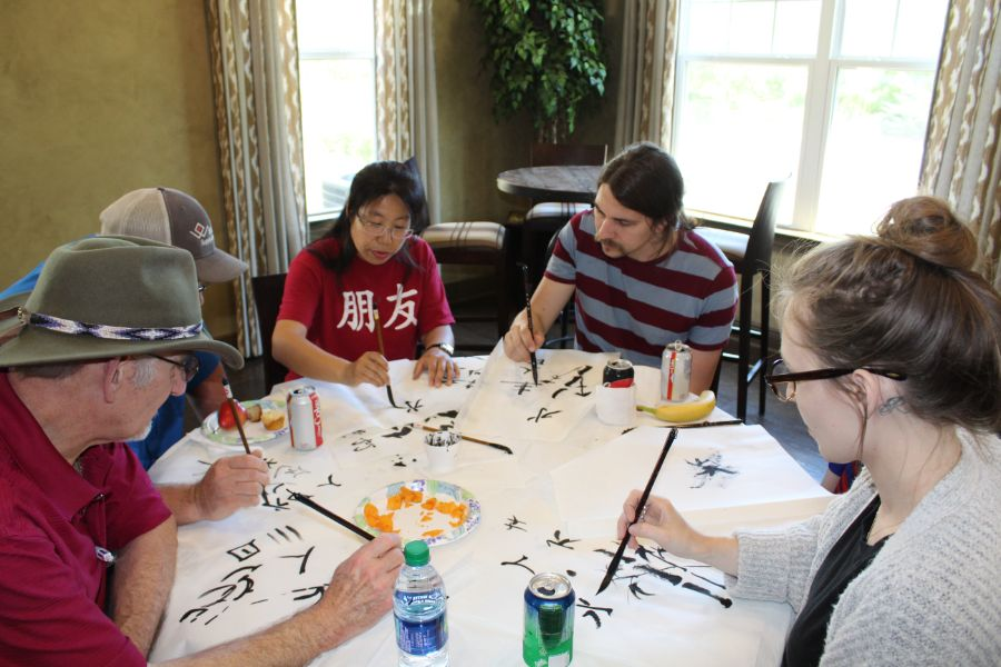 the locals were painting on Chinese paper with the instructions from visiting scholars at