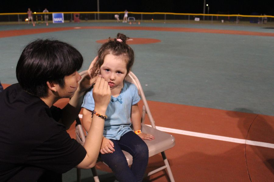 a little girl got her face painted at the event