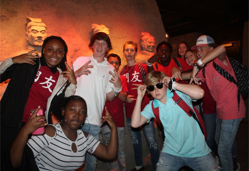 students took a funky picture with terracotta warriors