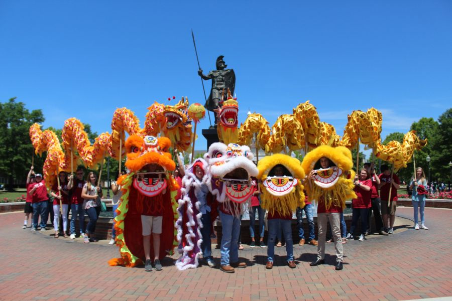 students took picture with lion heads