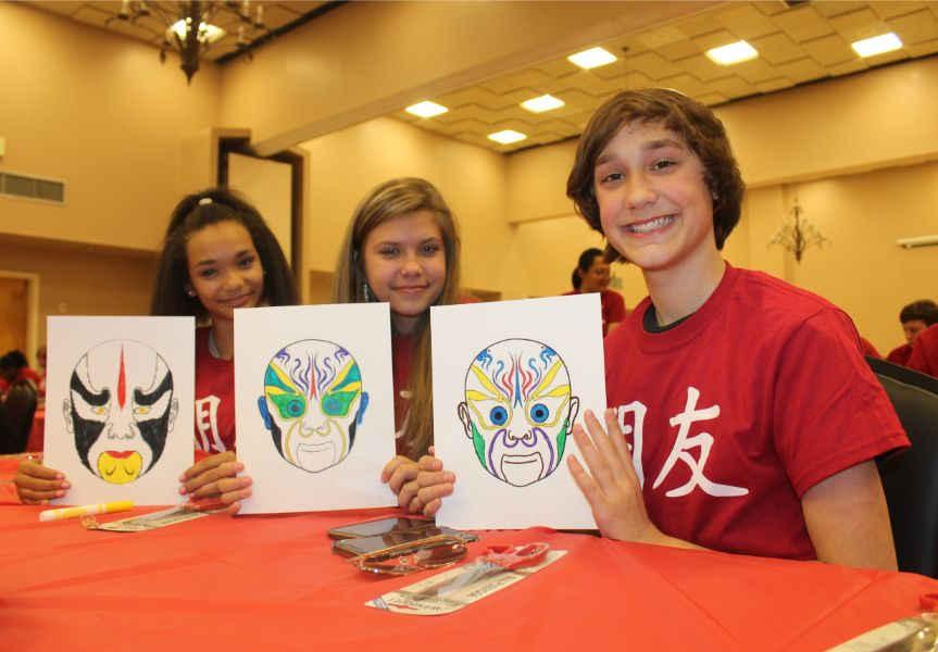 students proudly presented their handmade Chinese mask