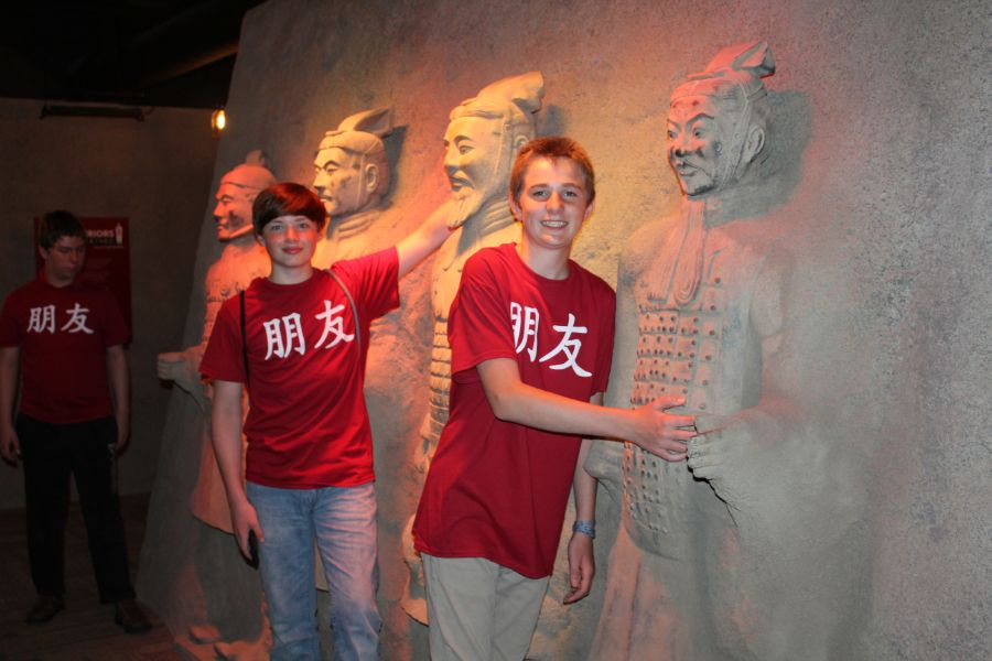 students took picture with terracotta warriors