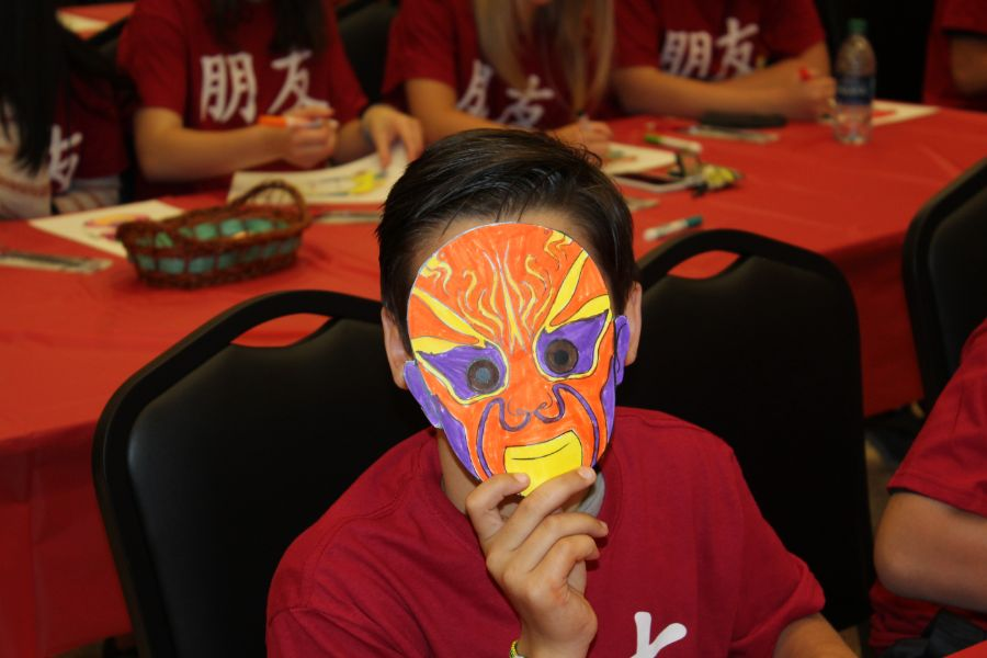student proudly presented his handmade Chinese mask