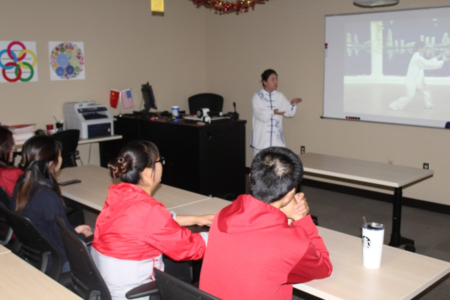 troy students were attentive to Li Wei's presentation