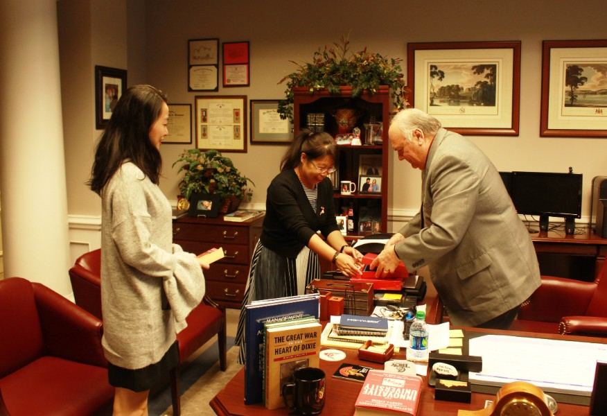 visiting scholars gave Dr. Jeffrey small gift from China