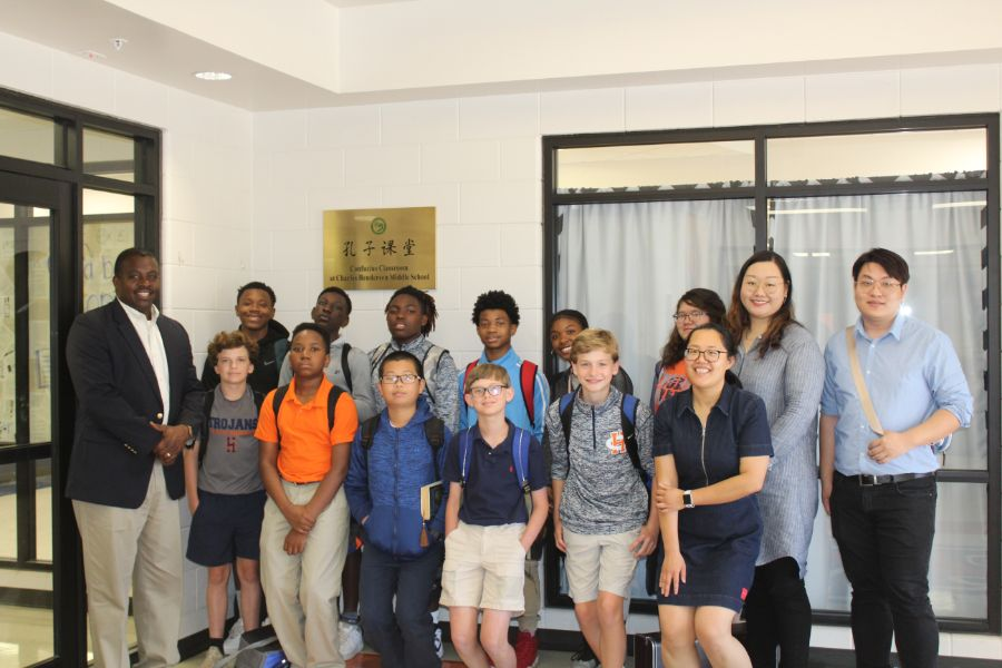 group picture of students from Charle Henderson elementary school with their language teacher, Yunchu Chang