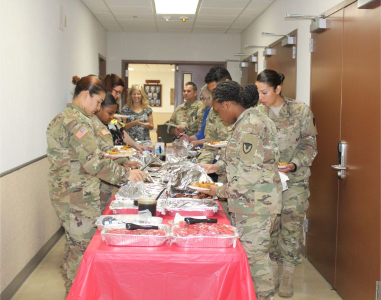 A picture, soldiers were having lunch with Chinese cuisines.