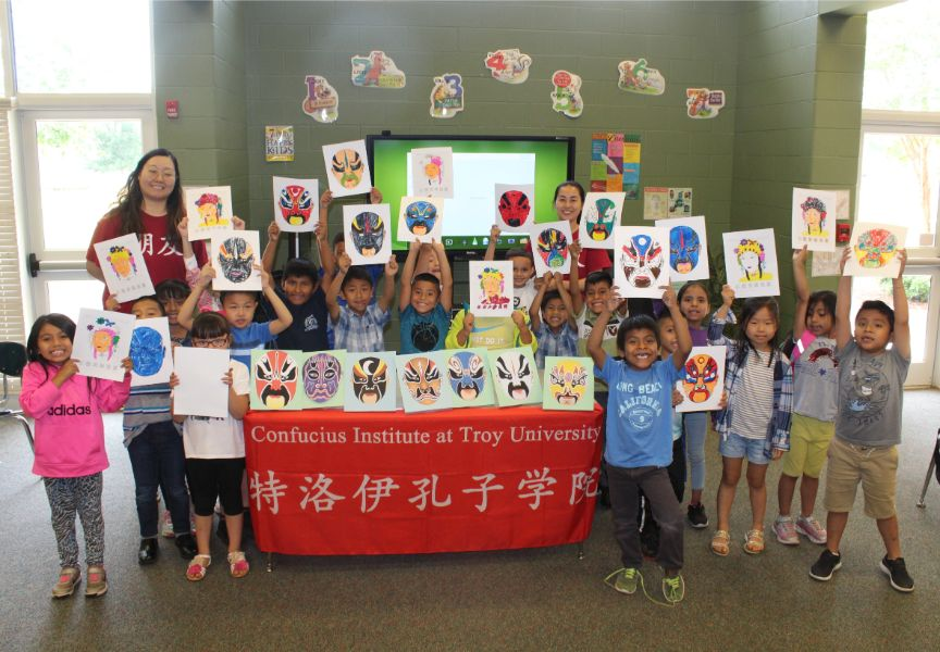 A group picture of students proudly showed their colored arts.