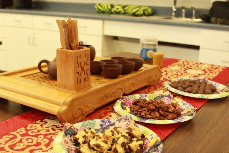 An appealing picture of Tea ceremony tray and Chinese sweets setup.