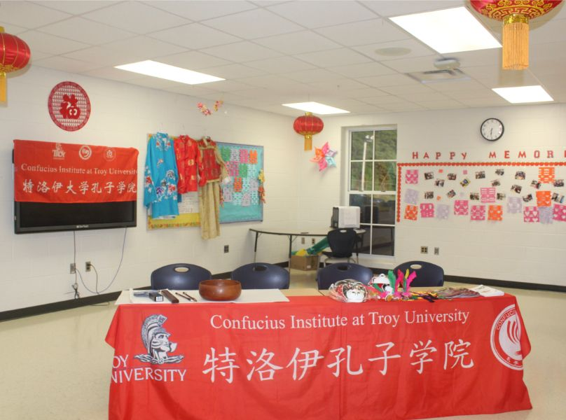 The Confucius Institute's set up at the open house includes calligraphy tools, traditional clothes, and fun art pieces.