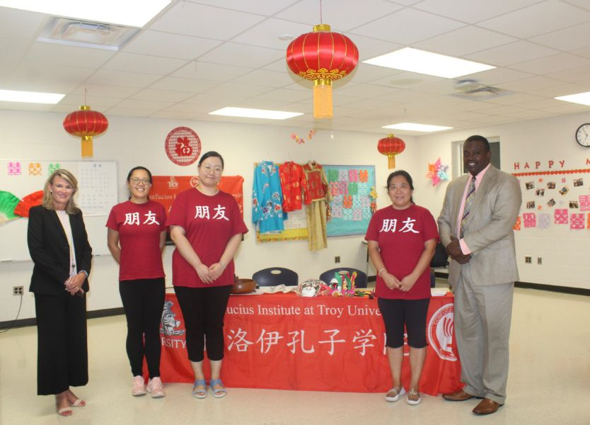 Visiting scholars and Confucius Institute members join with the Principal, Aaron Brown, and Assistant Principal, Lise Fayson, of Charles Henderson Middle School.