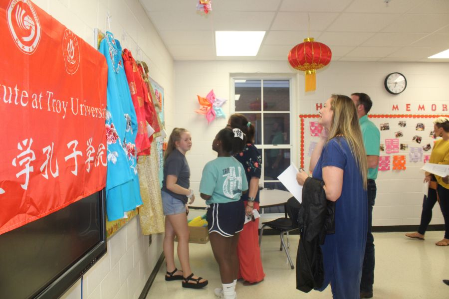 Parents and students appreciate the pieces of traditional Chinese dress and other elements displayed in the classroom.