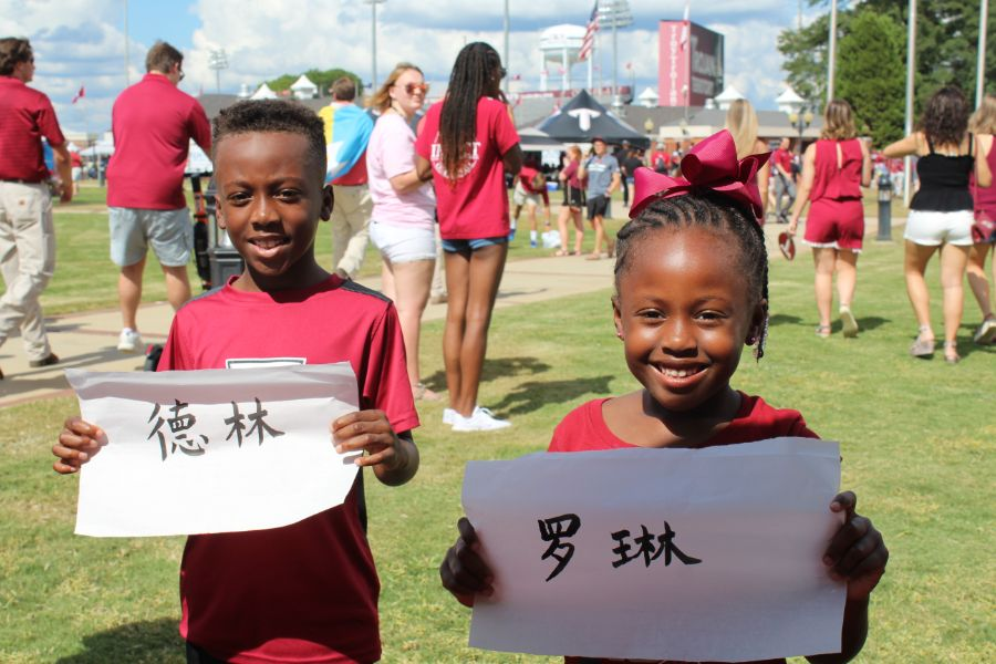 CIT event visitors happily pose with their names written in Chinese calligraphy.