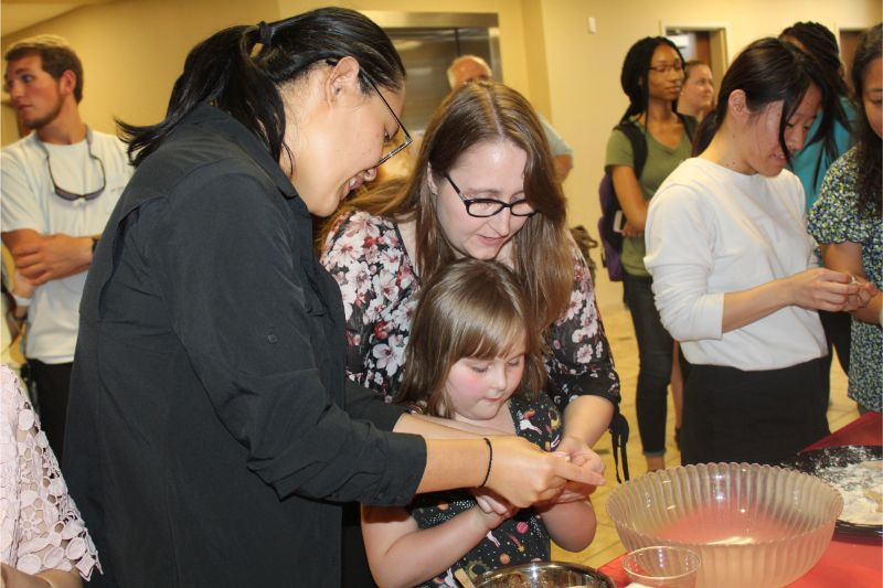 CIT Visiting Scholar He Jing shows parents and children how to make Chinese dumplings.