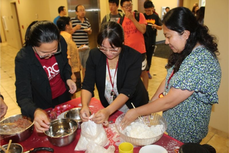 CIT Scholars He Jing, Wenjuan Cheng, and Dr. Rui Zhang prepare dumplings and material for Mid-Autumn Festival Celebration.