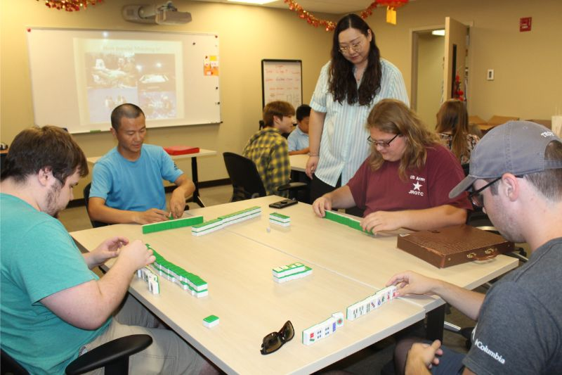 Students at Troy play Mahjong together.