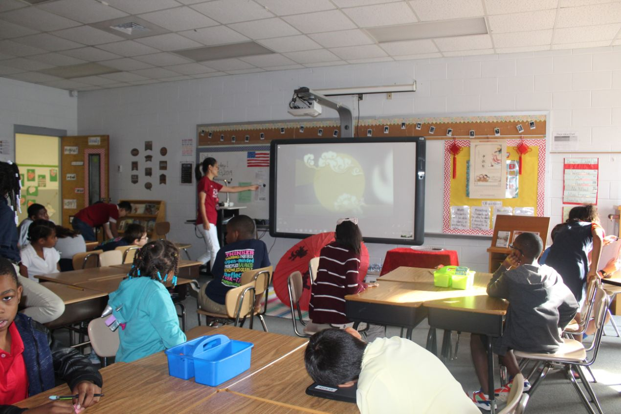 Children at Kelly Springs Elementary watch movie about the Mid-Autumn tale.