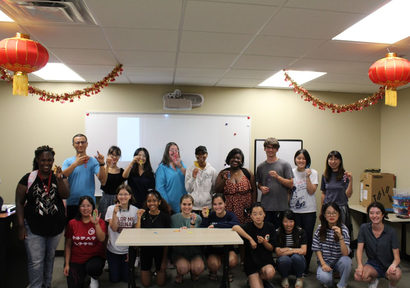 The students at the Chinese Tea Talk gather together for a group picture to show off their works.