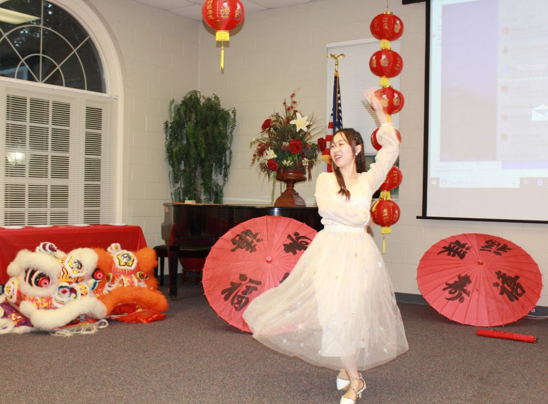 A Chinese dancer performs the Xin Jiang dance for the guests.